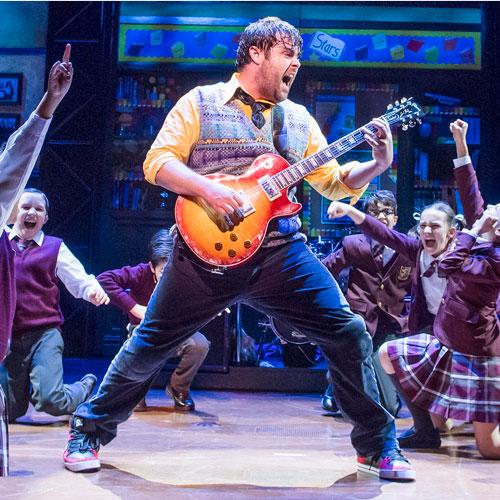 School of Rock actor playing guitar