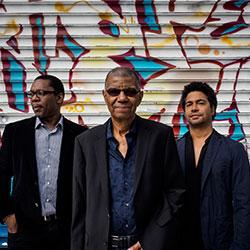 DeJohnette, Coltrane, and Garrison in front of a Graffiti wall